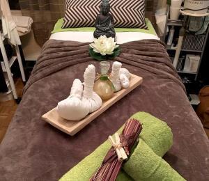 institut_perle_noire_massage_ayurvedique_tampons_chauds_2_1