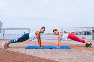 two-women-doing-push-ups-1671218